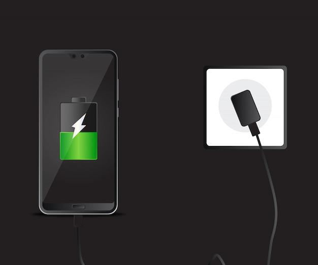 Mobile smartphones charging on black background.