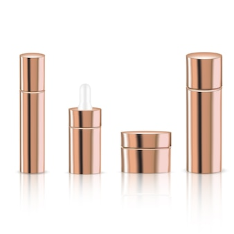 Mock up realistic rose gold pastel cosmetic bottles