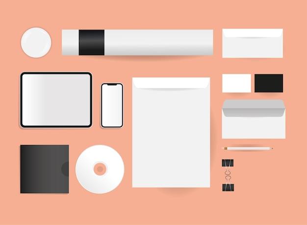 コーポレートアイデンティティテンプレートとブランディングテーマのモックアップ封筒cdタブレットとスマートフォンのデザイン