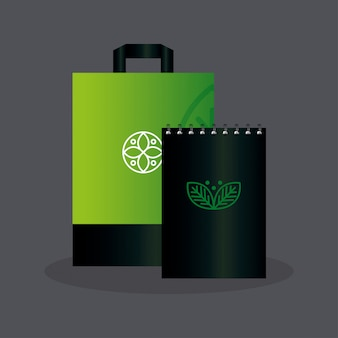 Mockup notebook and bag paper color green with sign leaves, green identity corporate