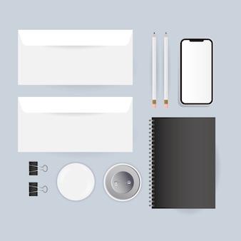 コーポレートアイデンティティテンプレートとブランディングテーマのモックアップノートスマートフォンと封筒デザイン