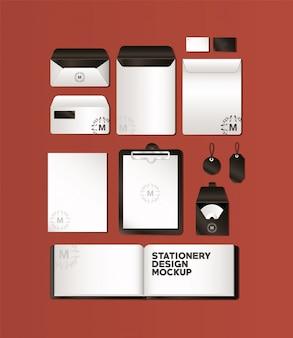 Набор мокапов с черным брендингом фирменного стиля и канцелярской тематики