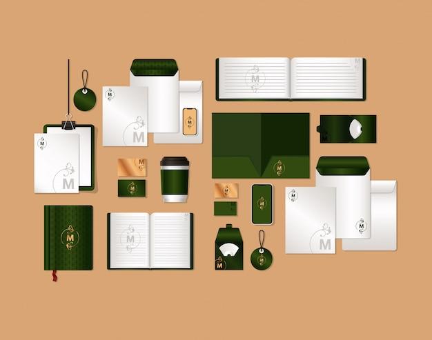 Набор макетов с зеленым и м логотипом фирменного стиля и канцелярской тематики