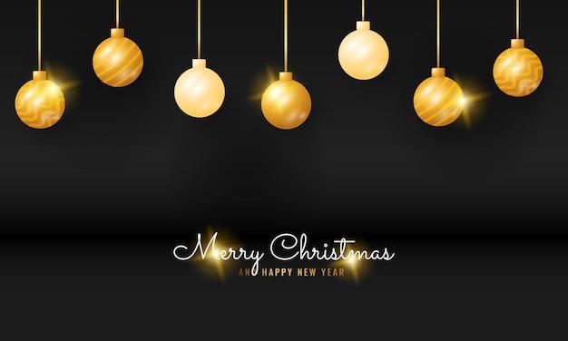 金色のぶら下げボールとモダンな黒のメリークリスマスと新年あけましておめでとうございますのバナー