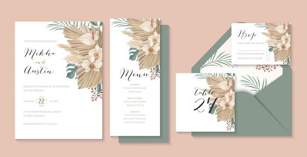 乾燥したヤシ、ススキ、モンステラ、オランダカイウユリ、蘭入りのモダンな自由奔放な熱帯の結婚式の招待状