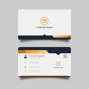 オレンジと黒のディテールがエレガントなデザインのプロのテンプレートと白のモダンな名刺