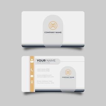 オレンジ色のディテールがエレガントなデザインのプロフェッショナルなテンプレートとモダンな名刺