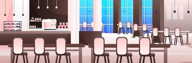 가구가 수평으로 있는 현대적인 카페 인테리어 비어 있는 사람이 없는 레스토랑