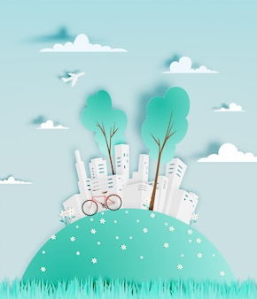 Modern city in paper art style with flower field vector illustration