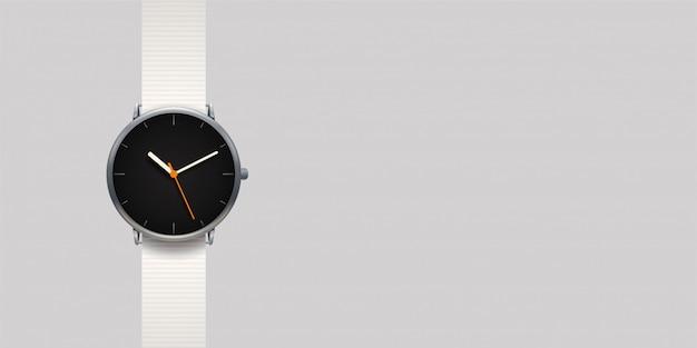 Современные классические часы на сером фоне