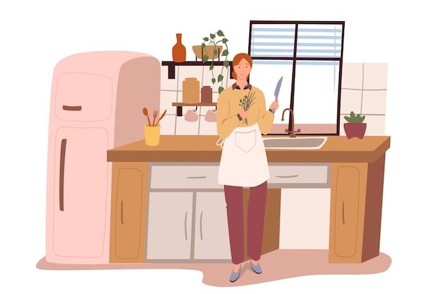 부엌 웹 개념의 현대적인 편안한 인테리어입니다. 냉장고, 테이블, 싱크대, 식기, 식물이있는 방에서 요리하는 여자