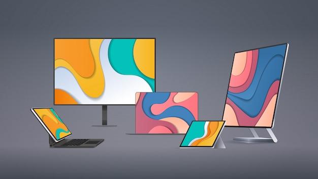 現代のコンピューターモニタータブレットラップトップ色の画面の現実的なガジェットとデバイスの概念