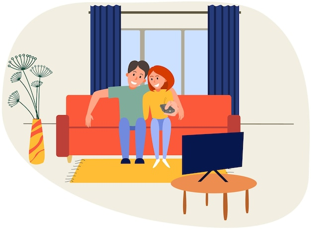 Modern couple watching tv in the living room on the sofa