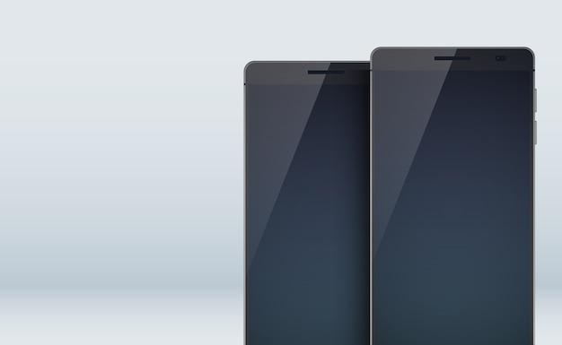 Collezione di set di concept design moderno con due eleganti smartphone neri con ombre sui grandi display vuoti e touchscreen sul grigio