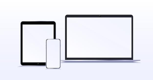 空白の画面を備えた最新のデバイスラップトップのスマートフォンと空白の画面を分離したタブレットのモックアップ