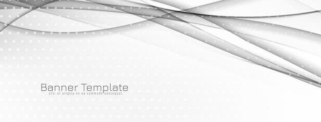 モダンでエレガントなグレーと白の波状のバナーデザイン