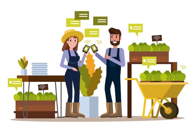 スマートフォンを使用している現代の農家