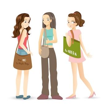 Modern girls holding fabric bag for shopping