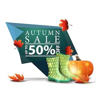 Современный зеленый геометрический дисконтный баннер на осеннюю распродажу с резиновыми сапогами и тыквой