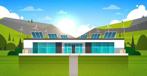 Modern house with wind turbines and solar panels alternative power eco friendly energy concept