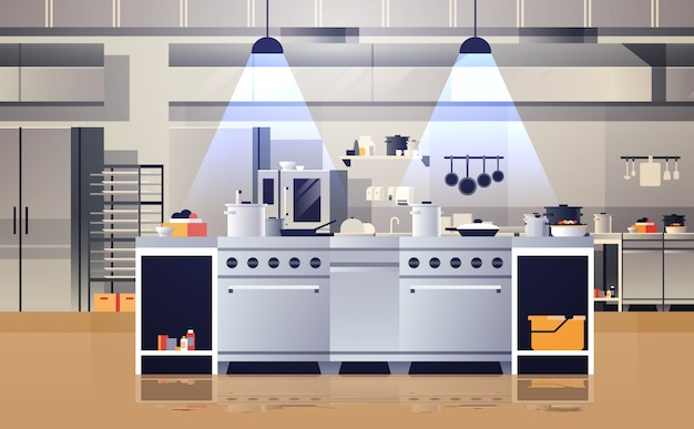 Modern interior of professional cafe or restaurant kitchen with kitchenware and equipment cooking