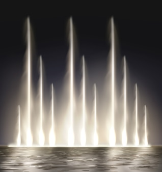 Modern lit night fountain illuminated on dark background