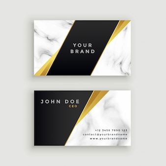 Modern marble business card with geometric golden shapes