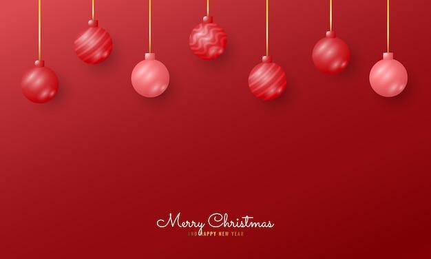現代のメリークリスマスとぶら下げボールと新年あけましておめでとうございますのバナーの背景
