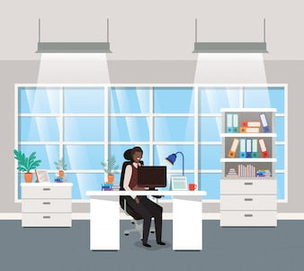 Modern office with black businessman sitting