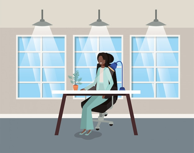 Modern office with black businesswoman sitting