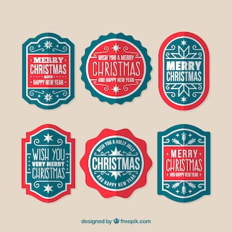 Modern pack of christmas badges Free Vector