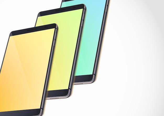 Modello di gadget portatili moderni con smartphone realistici e schermi vuoti colorati su bianco isolato