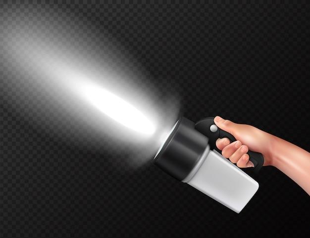 Modern powerful high lumen handheld torch flashlight in hand realistic composition against dark transparent