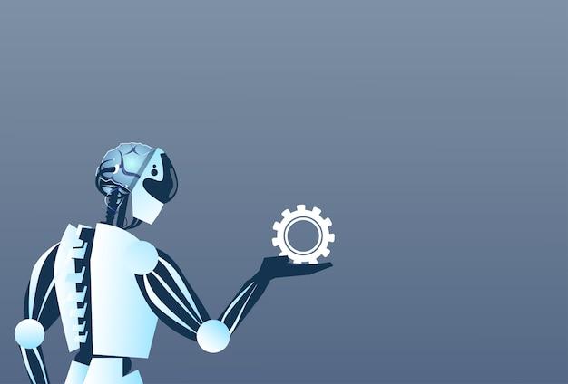 Modern robot hold cog wheel