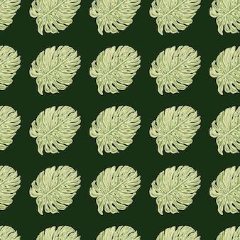 シンプルなスタイルのモダンなシームレスパターンは、モンステラのヤシの飾りを残します。濃い緑色の背景。