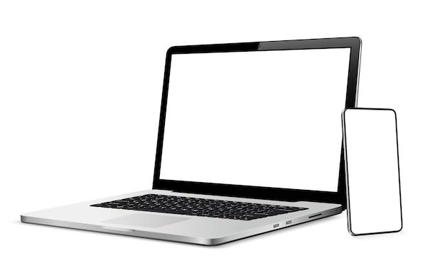 空白の画面を持つ現代のスマートフォンとラップトップ