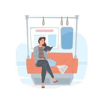 Современная женщина читает книгу в метро