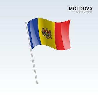 회색 배경에 고립 된 깃발을 흔들며 몰도바