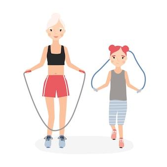 엄마와 딸 피트니스 운동 중 건너 뛰는 밧줄 점프. 신체 훈련을 수행하는 엄마와 아이
