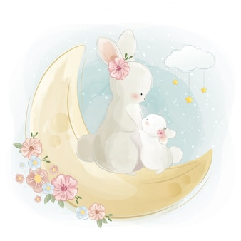 Mommy and baby bunny standing on the moon
