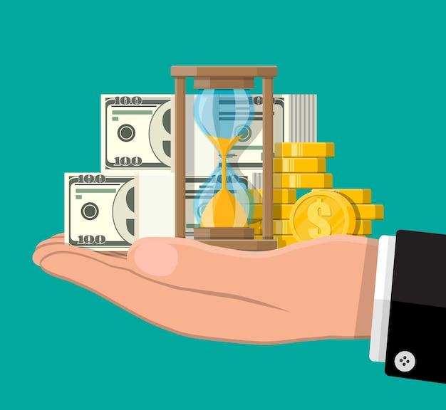 손에 모래 시계와 돈입니다. 투자 수익률, 금화 증가 차트. 성장, 소득, 저축, 투자.