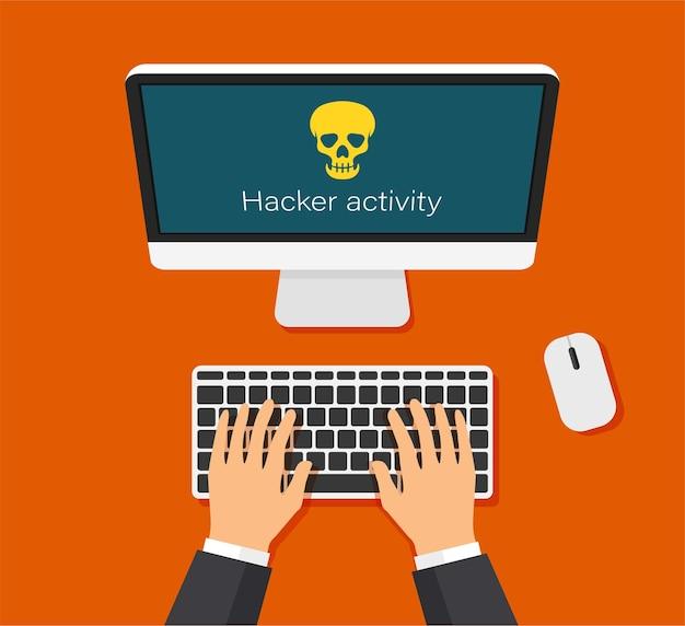 Монитор и предупреждение о вирусах взлом почты или компьютера рука печатает на клавиатуре