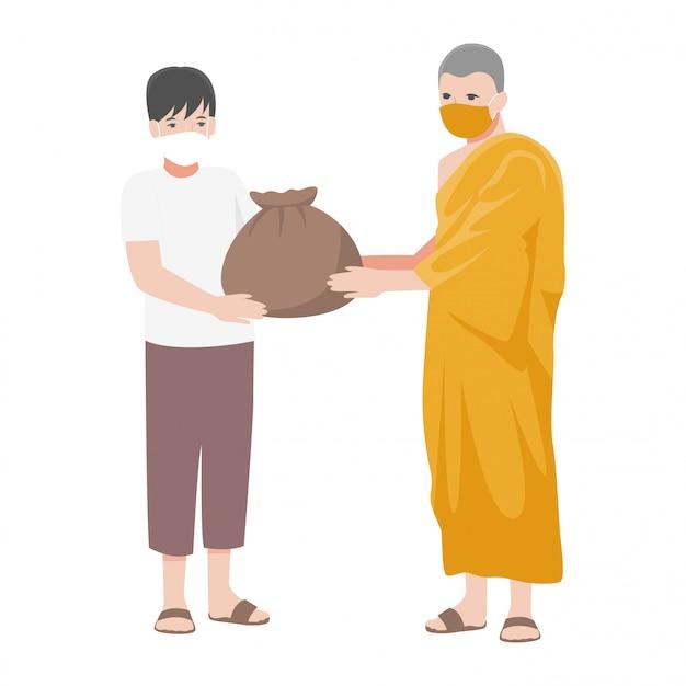 僧侶は貧しい人々にサバイバルバッグを提供し、外科用保護医療マスクを着用することで人々を助けます