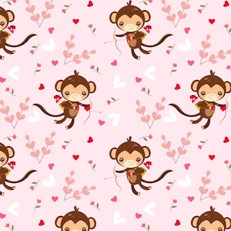 Monkey cupid and heart pattern on pink background
