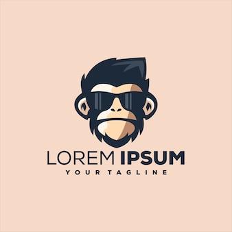 Дизайн логотипа в очках с головой обезьяны