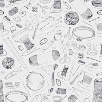 手描きの編み物や裁縫道具の手描きのモノクロのシームレスパターン