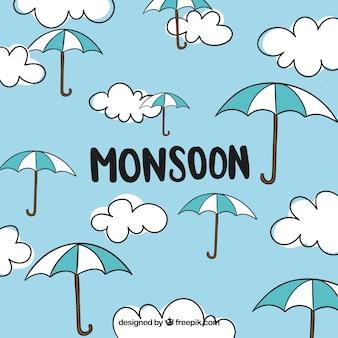雲と傘のあるモンスーン季節の背景