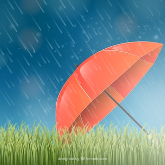 Monsoon season background with red umbrella