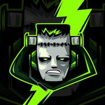 暗闇で隔離のハロウィーンのマスコットのロゴのモンスターまたはゾンビの頭