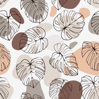 抽象的な形のシームレスなパターンとモンステラデリシオサの葉。